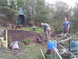 Paul and Lee at work on the herb tablet project, preparing and levelling the ground.